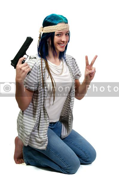 Beautiful crazy hippy woman with a handgun