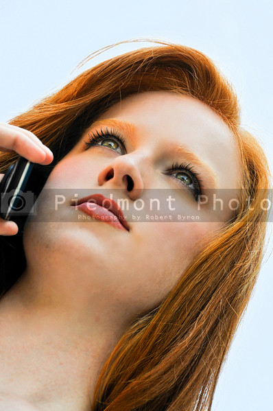 A young beautiful woman talking on the phone