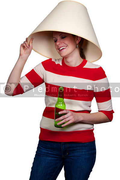 Women drinking adult beverages at a party wearing a lampshade