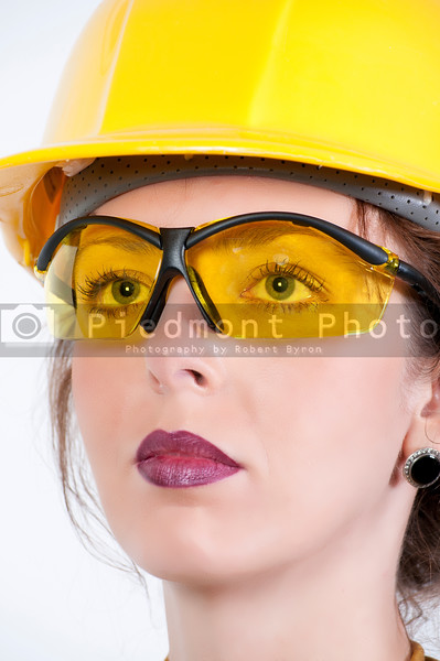 A beautiful young woman wearing safety glasses