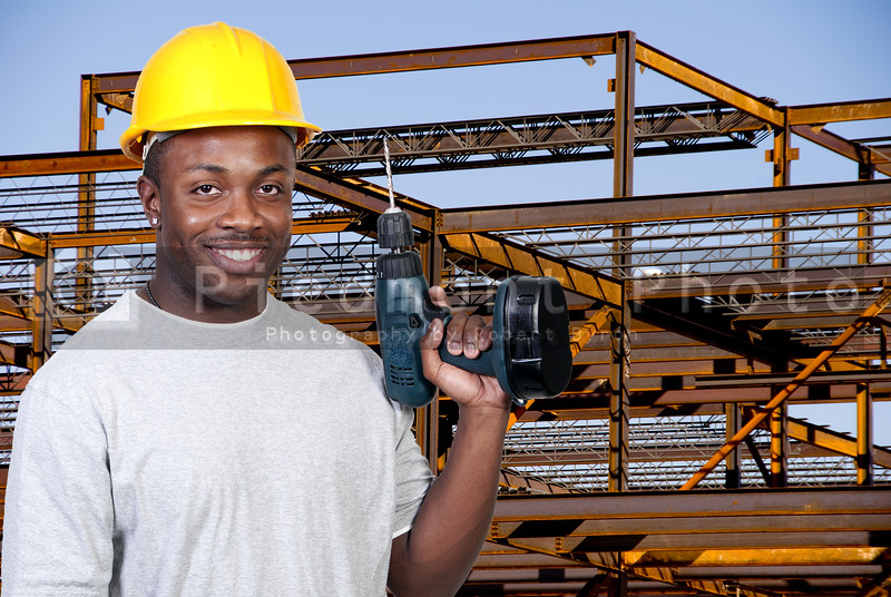 A black man African American construction worker a job site.