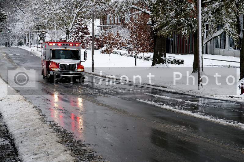 An ambulance driving to an emergency on a snow day