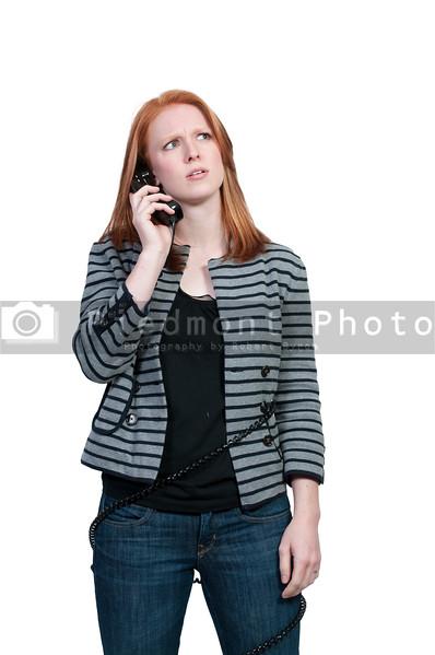 A beautiful woman talking on a phone