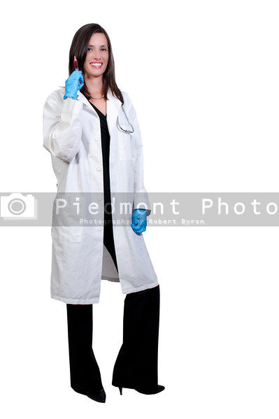 A young beautiful woman doctor with a medical syringe with medicine