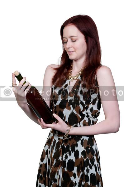 A beautiful  woman holding a wine bottle