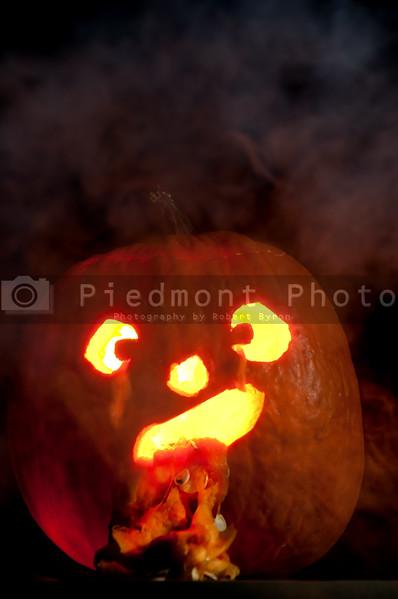 A lighted jack-o-lantern on a dark halloween night.