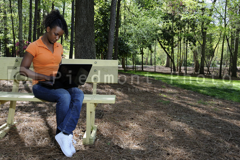 A college student working on a laptop