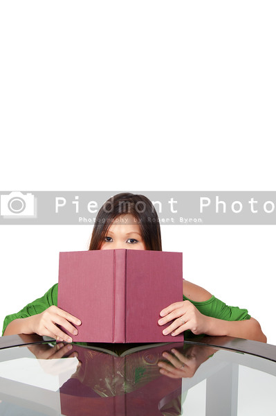A beautiful young hispanic woman reading a book