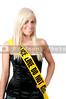 A beautiful woman wearing a police line sash