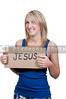 A beautiful young woman holding up a Jesus sign