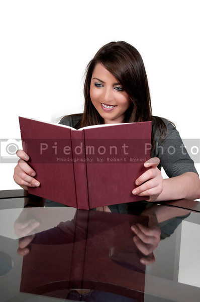 A beautiful young woman reading a book