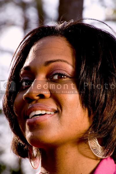 A close-up portrait of a smiling black woman