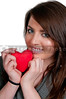 A beautiful young woman holding a healthy Valentines Day heart