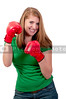 A young teenage girl learning to box