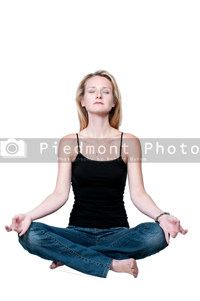 A beautiful woman doing her Yoga lotus position execises