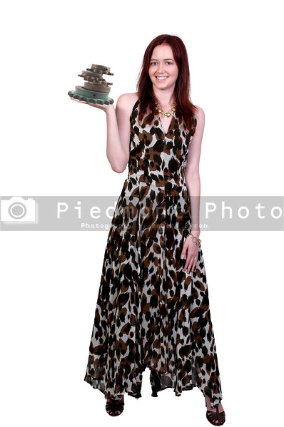 A young Beautiful Woman holding a stack of industrial sprockets