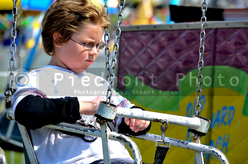 A young boy on a swing ride