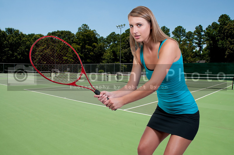 A beautiful woman playing the sports game of tennis