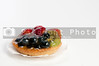 A delicious fruit tart with blueberries, strawberries and kiwi
