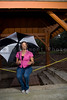 An African American woman under an umbrella