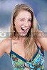 A flirting young Beautiful Woman winking and smiling