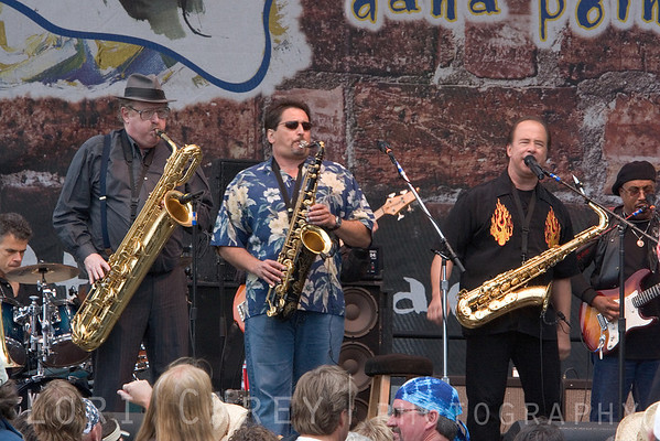 "Stephen ""Doc"" Krupka, Tom Politzer and Emilio Castillo of Tower of Power at the Doheny Blues Festival in Dana Point, California on May 21, 2006.  Drummer David Garibaldi in left background and newest member Trey Stone in right background."