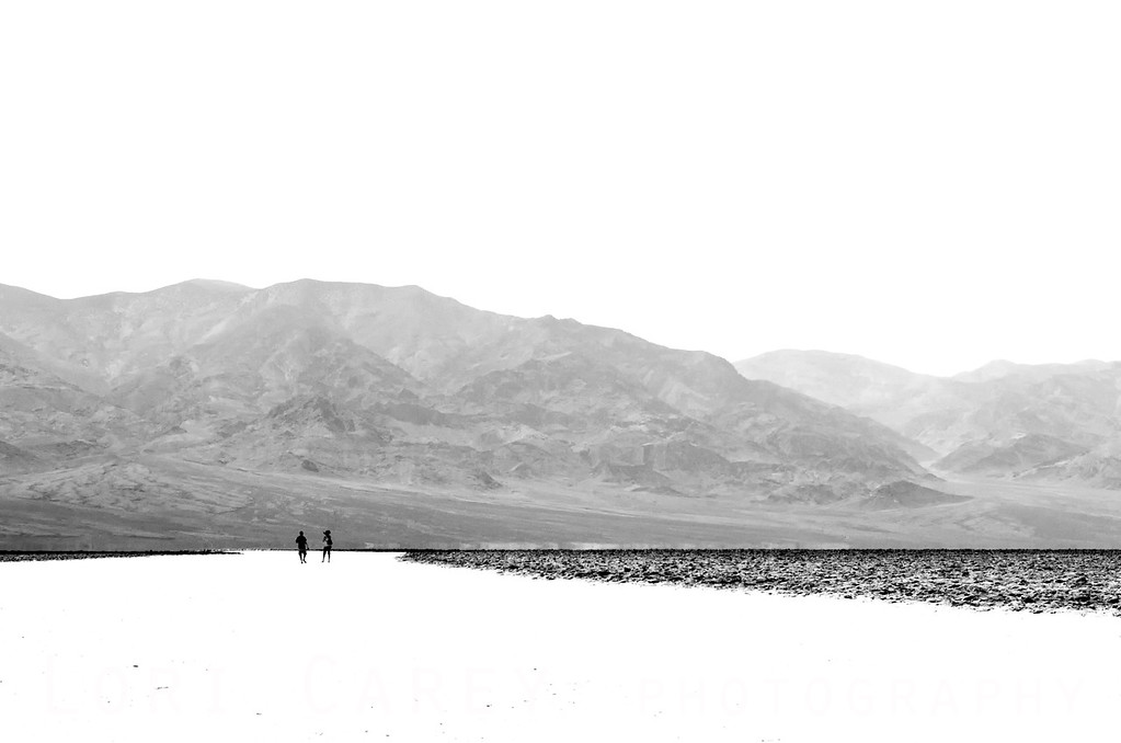 People walking on the salt flats of Badwater in Death Valley National Park during the June 2013 heatwave.