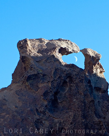 Moon rise through a rock formation at Hole in the Wall, Mojave National Preserve