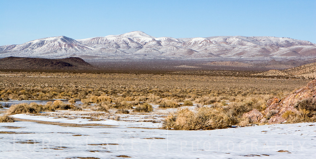 Snow-covered Mojave Desert in winter as seen from Inscription Canyon in the Black Mountain Rock Art District, San Bernadino County, California