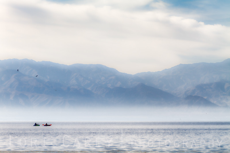 Two kayakers on the Salton Sea