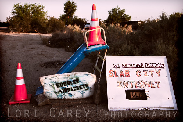 """""""We remember freedom"""" Signs for the Internet Cafe and the local band AirRacket in Slab City, a squatters' camp on an abandoned military base in the desert outside of Niland, California"""