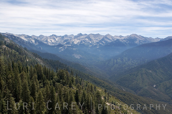 View of the Great Western Divide from Moro Rock. Moro Rock is 6725 feet high. The summit can be reached via a stairway cut into the side of the mountain; the quarter-mile climb ascends 300 vertical feet.