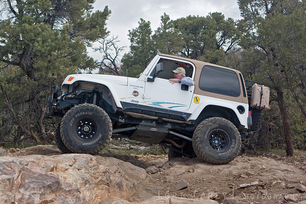 This section of Gold Mountain was deceiving; there were several lines one could choose from. This line looked to be one of the easier ones, but iit gave several people a bit of a problem if they didn't have lockers. This jeep is making it look easy.