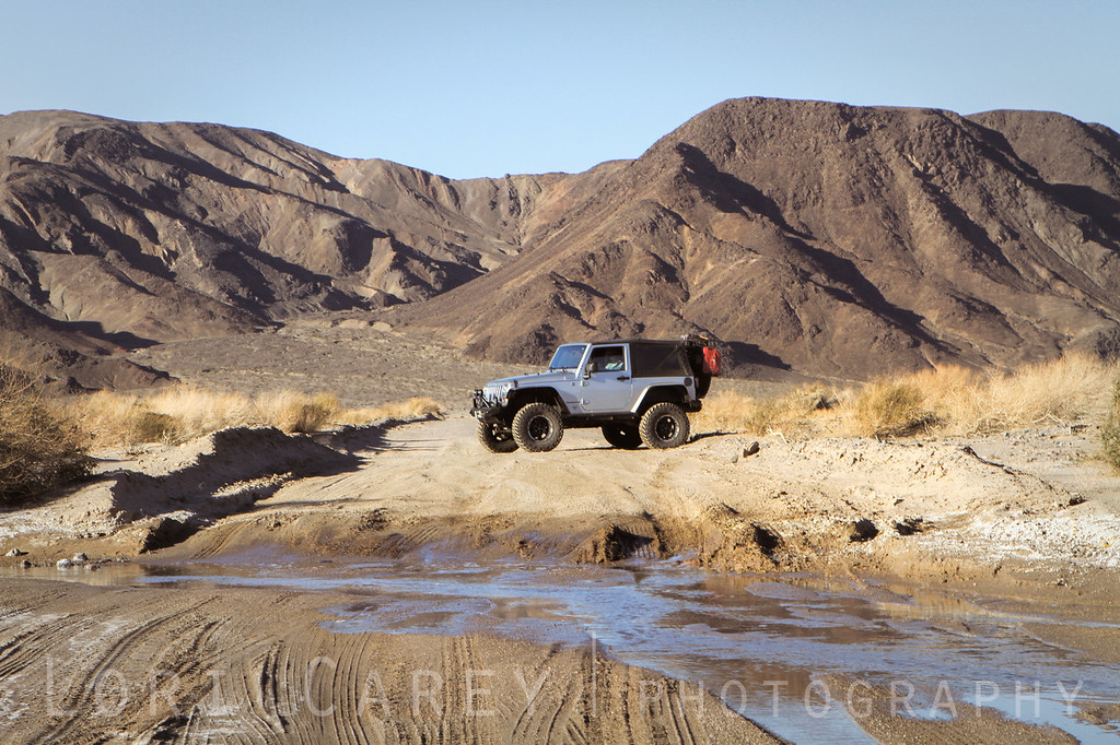 Jeep Wrangler at water crossing on trail to Saratoga Springs in Death Valley National Park