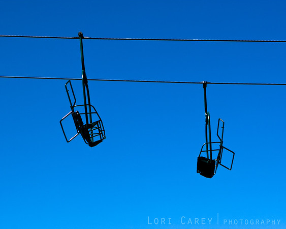 The chairlift silhouetted against a bright blue spring sky