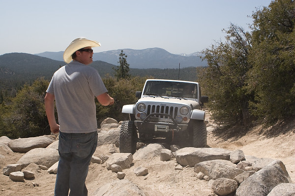 j-sack spotting a jeep through some rocks on John Bull trail