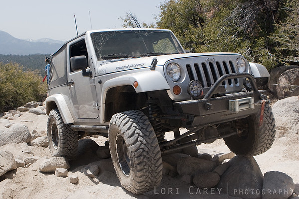 Jeep Wrangler crawling over rocks on John Bull trail in Big Bear