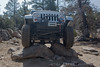 Jeep crawling over rocks on the John Bull trail in Big Bear, California