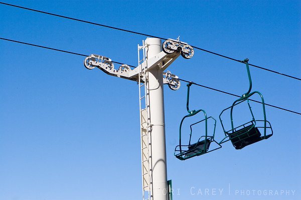 The chairlift was silent, waiting for next winter.