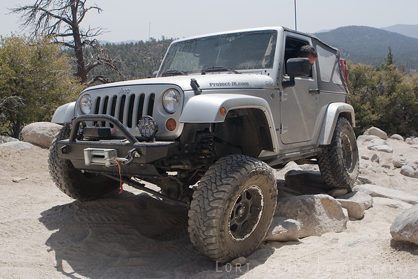 Jeep Wrangler crawling over rocks on John Bull trail
