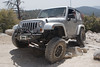 Jeep Wrangler crawling over rocks on John Bull trail