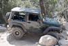 Rockrash navigating his jeep past some boulders on John Bull