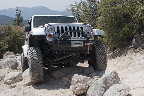 Jeep Wrangler crawling over rocks on John Bull trail in Big Bear