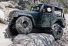 Jeep crawling over rocks on John Bull trail, Big Bear mountains, California
