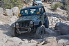 Jeep wrangler flexing on the rocks on John Bull trail