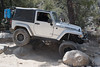 Jeep Wranlger flexing over some rocks on John Bull trail