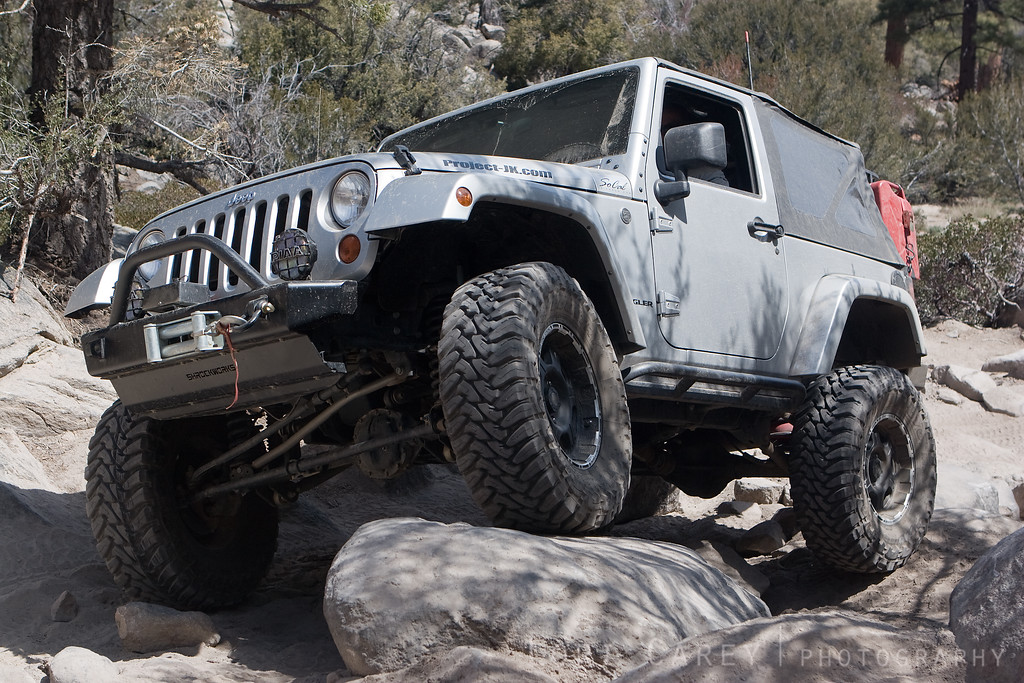 Jeep crawling over rocks on John Bull trail, Big Bear, California