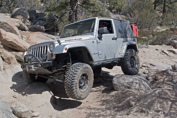 Jeep crawling over rocks on John Bull with one tire in the air