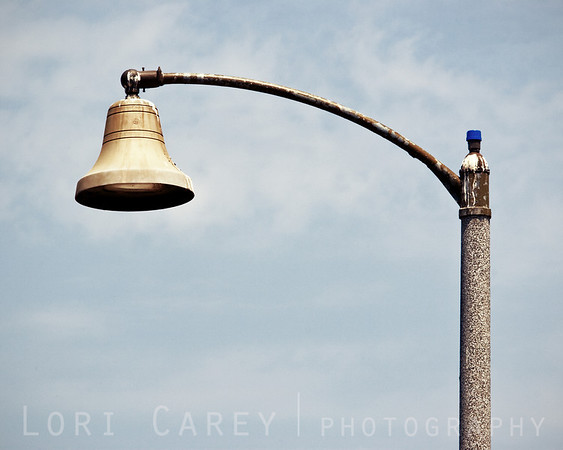This is the way I feel some days. <br> San Juan Capistrano, California street lights are shaped like Mission bells.