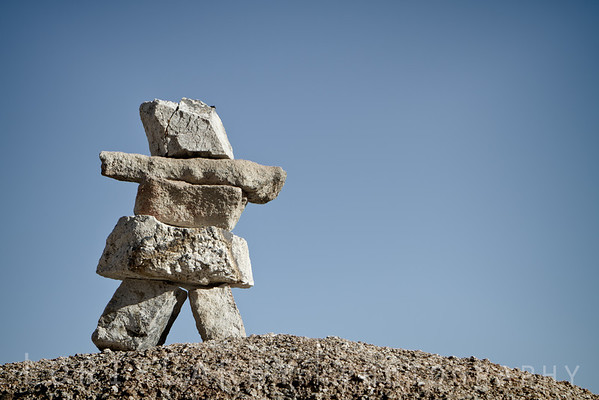 An inuksuk, more specifically an inunnguaq, stone cairn in the shape of a man in the Alabama Hills of California